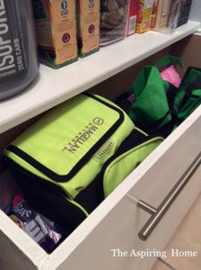 view of under shelf storage bins