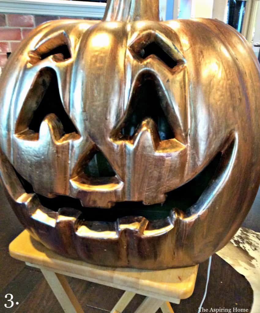 Step 3 Apply precious metal paint in bronze updating outdoor jack o' lanterns