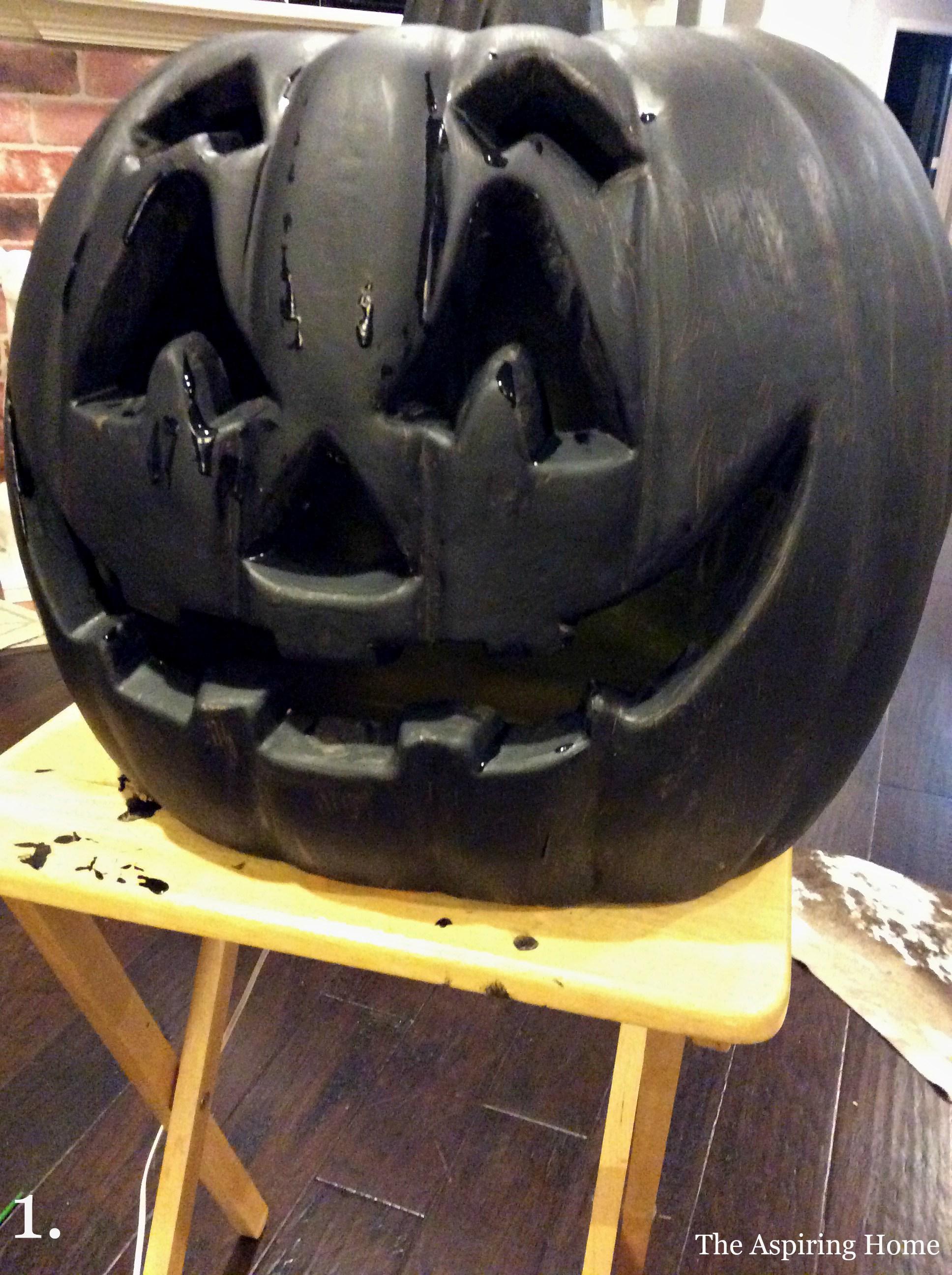 Step 1 paint pumpkins in flat black updating outdoor jack o' lanterns