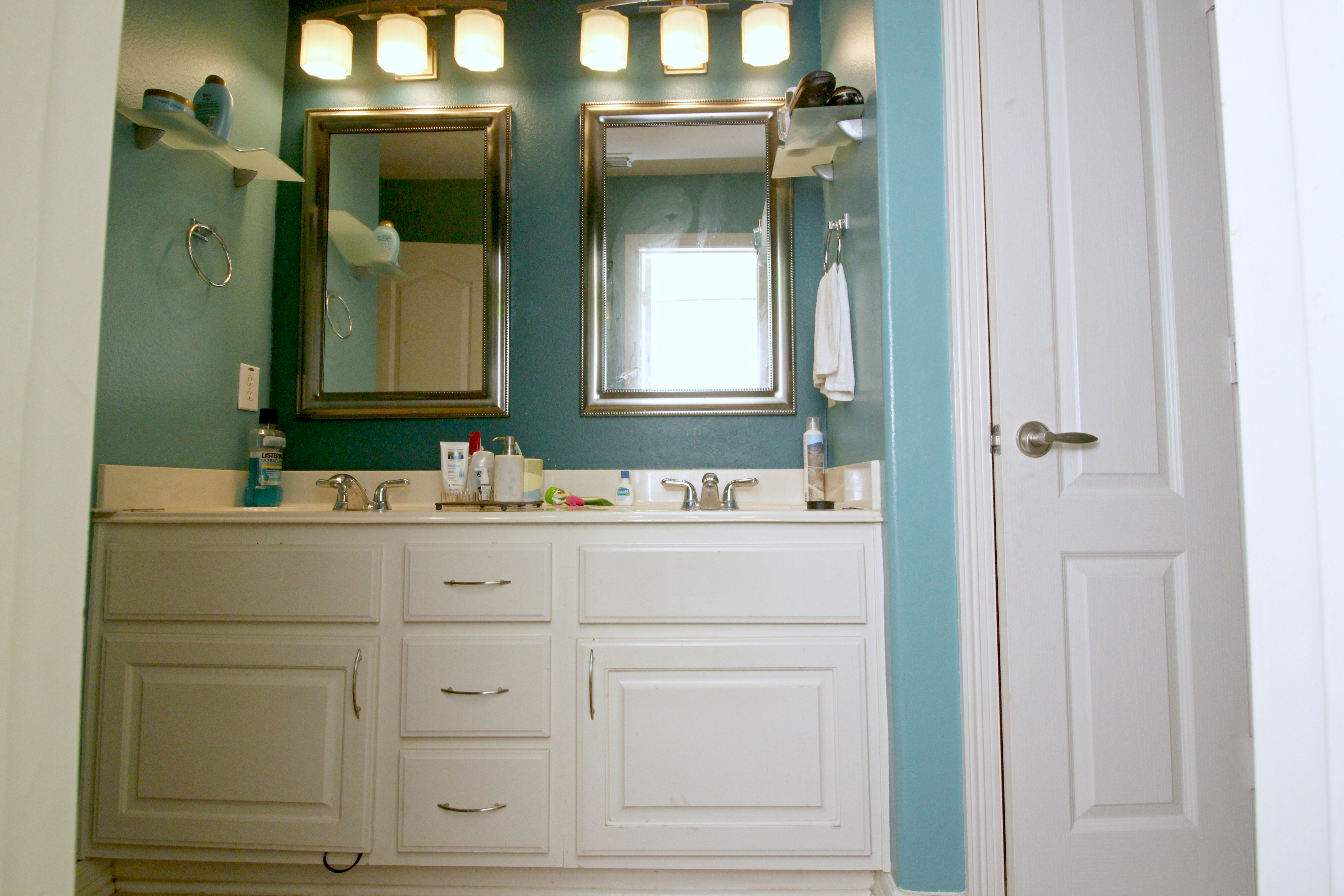 full view of small vanity before ugly duckling bathroom renovation