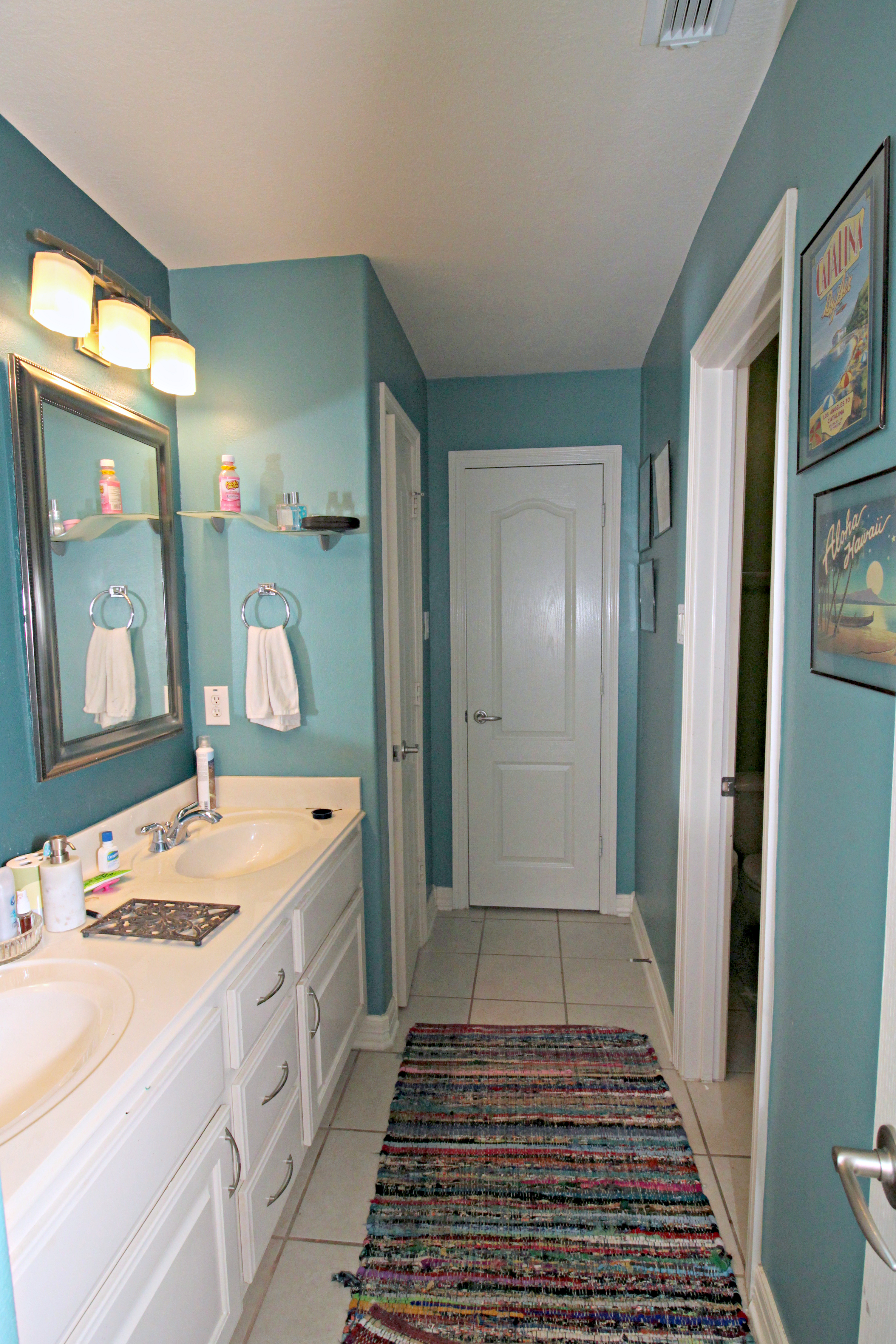 ugly duckling bathroom before pictures full view of vanity and linen closet