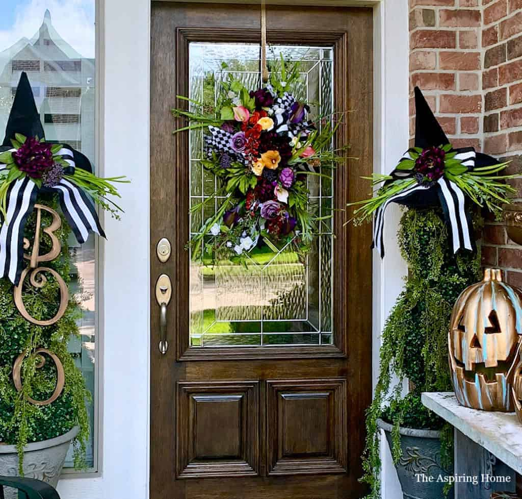Halloween Porch with door swag and witch's hat topiary