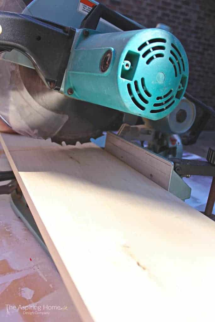 using a chop saw to make the cuts for the outdoor stone entry table