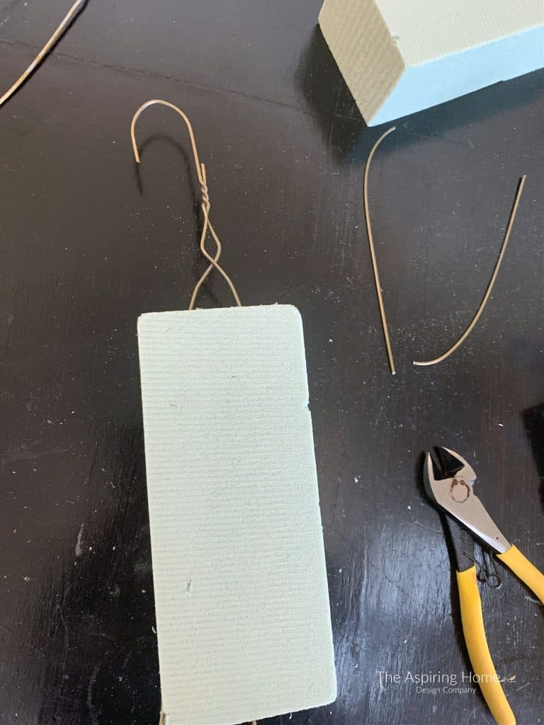 insert coat hanger into floral foam