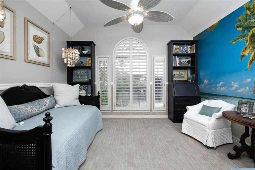 tropical bedroom with understated cabinet hardware on built in bookshelves